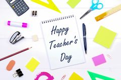 Text on paper: Happy Teacher's Day. School supplies, office, books, apple. Text on paper: Happy Teacher's Day. School supplies, office, books apple Royalty Free Stock Photos