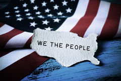 Text we the people and flag of USA Stock Image
