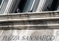 Text Piazza San Marco and pigeons in venice, Italy Stock Image