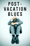 Text post-vacation blues and a businessman curled up with his he Stock Images