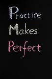 Text of Practice makes perfect. Written with chalk on a blackboard Royalty Free Stock Image