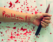 Text problem on Woman's arm commit suicide. By knife Royalty Free Stock Photography