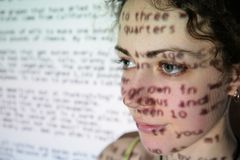 Text is projected on face of woman Royalty Free Stock Photo
