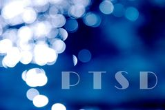 Text ptsd on a blue bokeh abstract light background. Water reflection Royalty Free Stock Photography
