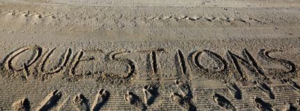 Text QUESTIONS on the sand of the beach stock photo