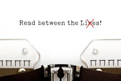 Read Between The Lies Concept On Typewriter. Text Read Between The Lies typed on vintage typewriter. The usually used word in the original idiom Lines is changed stock images