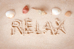 Text Relax writing on sand at the beach Royalty Free Stock Photo