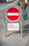Retirement ?. Text `retirement ? start again as writer or artist or in business` written in bold red on a stop or no entry sign, background is a street scene royalty free stock photography