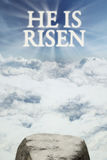 Text he is risen on the sky Stock Photography