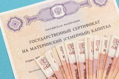 Text Russian Federation State certificate on maternity family capital and much money notes five thousandths. State support for. Family at birth of second child stock image