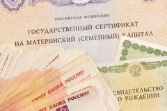 Text Russian Federation State certificate on maternity family capital and much money notes five thousandths. State support for. Family at birth of second child royalty free stock photos
