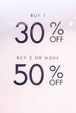 Text sale 30 and 50 off on the white paper in the shopping mall of Bali island, Indonesia. Royalty Free Stock Photos