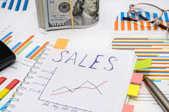 Text sales at notebook with analytic graphs and charts Royalty Free Stock Photography