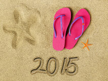 2015 text on sand. And beach accessories Royalty Free Stock Photo