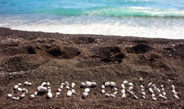 Text Santorini made ​​with pumice stones Stock Photo
