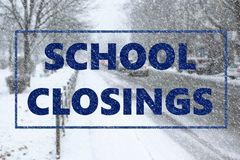 Text SCHOOL CLOSINGS and snowy street. On background royalty free stock image