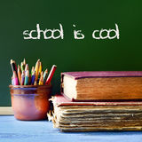 Text school is cool written in a chalkboard Stock Photos