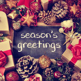 Text seasons greetings, gifts and christmas ornaments, retro eff Royalty Free Stock Photography