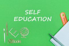 Text self education, school supplies wooden miniatures, notebook on green background. Concept school, text self education, school supplies, notebook, ruler and Royalty Free Stock Images