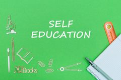 Text self education, school supplies wooden miniatures, notebook with ruler, pen on green backboard. Concept school, text self education, school supplies wooden Royalty Free Stock Photos
