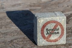 Text Sexual Abuse. And restriction sign written on a square stone stock photography