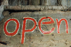 Text sign is open on a wooden board. Signboard open on wooden background Stock Images