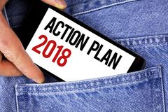 Text sign showing Action Plan 2018. Conceptual photo Plans targets activities life goals improvement development written on Mobile. Text sign showing Action Plan Stock Image
