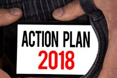 Text sign showing Action Plan 2018. Conceptual photo Plans targets activities life goals improvement development written on Mobile. Text sign showing Action Plan Stock Images