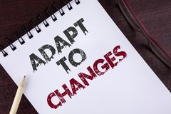 Text sign showing Adapt To Changes. Conceptual photo Innovative changes adaption with technological evolution written on Notepad o. Text sign showing Adapt To Stock Images