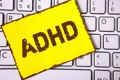Text sign showing Adhd. Conceptual photo Learning made easier for children teaching no more a difficult task written on Yellow Sti stock photography