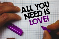 Text sign showing All You Need Is Love Motivational. Conceptual photo Deep affection needs appreciation romance Man hold holding p. Urple marker notebook page stock photos