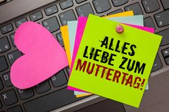 Text sign showing Alles Liebe Zum Muttertag. Conceptual photo Happy Mothers Day Love Good wishes Affection Bright colorful written. Papers pinch by pin pink royalty free stock images