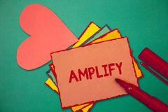 Text sign showing Amplify. Conceptual photo Make something bigger louder increase the volume using amplifier.  stock photography