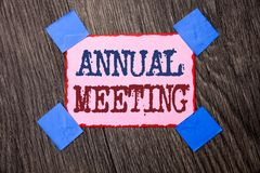 Text sign showing Annual Meeting. Conceptual photo Yearly Company Assembly Business Conference Report Event written on Pink Sticky. Text sign showing Annual stock image