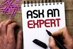 Text sign showing Ask An Expert. Conceptual photo Consult a Professional Asking for Advice Make a Question written by Man Holding. Marker Notebook Book the jute Stock Photo