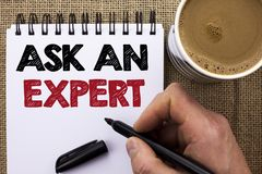 Text sign showing Ask An Expert. Conceptual photo Consult a Professional Asking for Advice Make a Question written by Man Holding. Marker Notebook Book the jute Royalty Free Stock Image