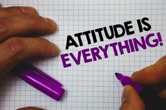 Text sign showing Attitude Is Everything. Conceptual photo Personal Outlook Perspective Orientation Behavior Man hold holding purp. Le marker notebook page stock photography