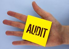 Text sign showing Audit. Conceptual photo Local company auditors perform their financial investigation annually written on Yellow. Text sign showing Audit Stock Photos
