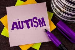 Text sign showing Autism. Conceptual photo Autism Awareness conducted by social committee around the globe written on Sticky note. Text sign showing Autism Royalty Free Stock Photo