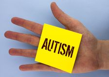 Text sign showing Autism. Conceptual photo Autism Awareness conducted by social committee around the globe written on Yellow Stick. Text sign showing Autism Stock Photo