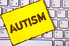 Text sign showing Autism. Conceptual photo Autism Awareness conducted by social committee around the globe written on Yellow Stick. Text sign showing Autism Royalty Free Stock Image