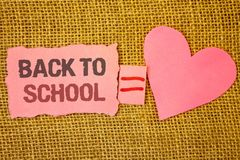 Text sign showing Back To School. Conceptual photo Return to class first day of studies Classroom Arriving Text pink torn note equ. Als is pink heart love royalty free stock images