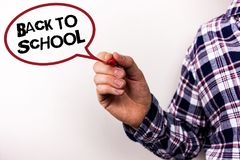 Text sign showing Back To School. Conceptual photo Return to class first day of studies Classroom Arriving Text white background m. An hand red marker shirt work Stock Photography