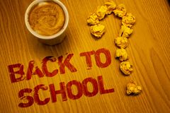 Text sign showing Back To School. Conceptual photo Return to class first day of studies Classroom Arriving Words written Desk Coff. Ee White mug crumbled paper stock photography