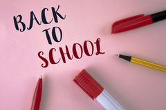 Text sign showing Back To School. Conceptual photo Right time to purchase schoolbag, pen, book, stationary written on plain Pink b. Text sign showing Back To Royalty Free Stock Photos