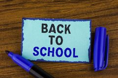 Text sign showing Back To School. Conceptual photo Right time to purchase schoolbag, pen, book, stationary written on Sticky Note. Text sign showing Back To Royalty Free Stock Photo