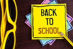 Text sign showing Back To School. Conceptual photo Right time to purchase schoolbag, pen, book, stationary written on Yellow Stick. Text sign showing Back To Royalty Free Stock Image