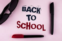 Text sign showing Back To School. Conceptual photo Right time to purchase schoolbag, pen, book, stationary written on plain backgr. Text sign showing Back To Royalty Free Stock Images