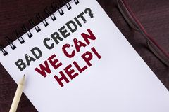 Text sign showing Bad Credit Question We Can Help Motivational Call. Conceptual photo achieve good debt health written on Notepad. Text sign showing Bad Credit royalty free stock photography