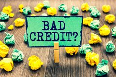 Text sign showing Bad Credit question. Conceptual photo history when it indicates that borrower has high risk Clothespin holding g. Reen note paper crumpled royalty free stock photos